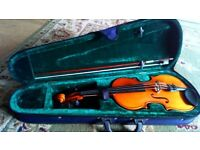 1/2 size violin with case used but in great condition
