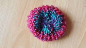 Handmade knitted scrubbies used for body or cleaning your home
