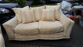 Two seater fabric beige sofas