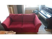 Lovely chic red sofa bed - excellent condition and not faded - couch