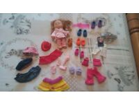 Lovely little doll with accessories and lots of clothes
