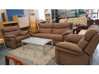 Large brown two seater fabric sofa with matching chair and electric recliner seat