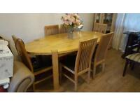 Solid Oak table with six chairs