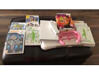 Wii console with all wires and sensor bar, 10 games and Wii for board