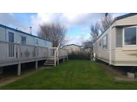 cheap static caravan with full side deck for sale call 07563105860