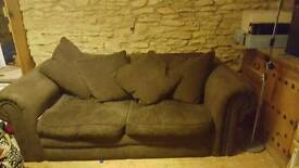 Large Brown 2 seater sofa free to collector.