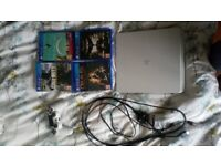 White playststion 4 with 1 controller and 4 games