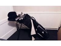 Set of MacGregor golf clubs