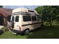 Campervan, £2,000, only 65k miles, battered but reliable.