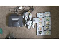 N64, 2 controllers and games Super Smash Bros, Zelda and more