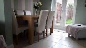 Swanley oak dining table and 6 cream chairs