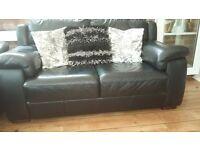 Black Italian leather two seater sofa with dark wood feet