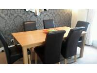Dining table c/w six brown chairs