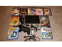 Playstation 2 slim plus 2 controllers and 10 games plus all leads