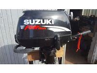 Suzuki four stroke outboard motor. 4 hp short shaft