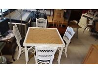 White Wicker Dining Table in Good Condition With Four Chairs