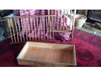 Wooden adjustable depth cot with under drawer.