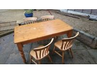 Pine kitchen table and 4 chairs, for sale.