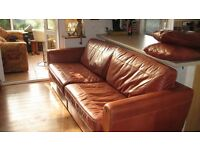 TWO TAN LARGE LEATHER SOFAS , MATCHING