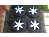 4 Steel Wheels 15 inch with Tyres 195/65/15 and Renault wheel trims