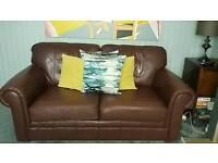 Dark tan leather sofa