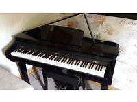 Baby grand piano. Like New