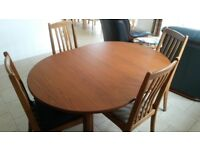Oval extending dining room table and 4 chairs