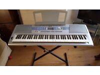 Yamaha DGX 200 portable grand keyboard and stand