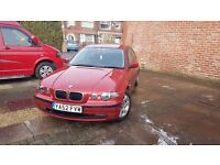 BMW 318ti Compact, 65,000 miles, manual, red, good condition.