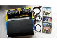 Playstation PS3 500gb superslim, with box, 2 Sony dual shock controllers + all leads
