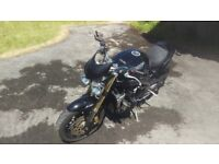 Triumph Speed Triple 1050 black, seat cover, low slip on exhaust, bar end mirrors