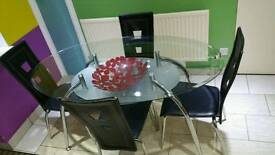 Glass table in used condition!chairs are go free cos not good enough! Can deliver! Thank you