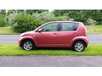 Daihatsu Sirion 1.3 SE 5dr red 2005 77000 miles warranty full service history ,