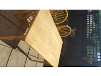 Pine dining/kitchen table and three bow back chairs