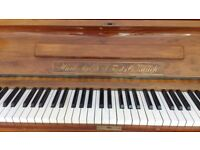 Upright piano. Good condition recently tuned. Cross strung on metal frame.