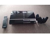 PS3 c/w 4 games, wireless controller & remote control