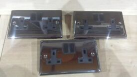 brushed chrome and black gloss sockets and light switches 2 of the sockets have usb built in