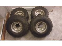Set of 100 cc quad wheels and tyres