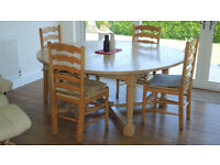 Large light oak round dining table (1.76m diameter) and 8 matching chairs