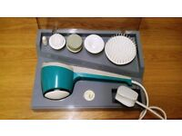 Electric hand held massager