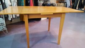 Wooden extendable dining table