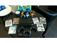 Playstation 3 slim plus controllers and games