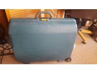 6 Large Suitcase - 2 wheeled, 3 Samsonite, 1 Trident 1 Carlton, 1 Eminent