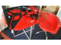 PRICE REDUCED. Moderne rose motif tempered glass table w/4 height adjustable chairs in black and red