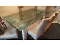 Extendable frosted dinning table with FREE chairs (REDUCED)