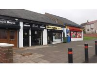 Retail outlet in row of shops in residential area with easy parking. Great potential.