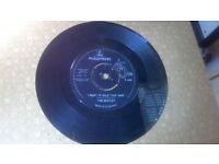 Original vintage pair of Beatles vinyl 45s
