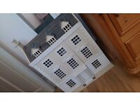 Dolls house...wooden dolls house opening front.good condition. .wooden furniture included