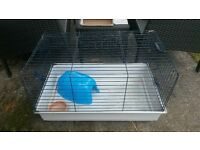 Indoor cage for guinea pig or small bunny.
