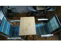 Pair of folding chairs and one wooden folding table